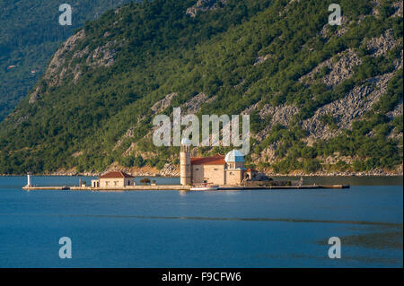 Montenegro island with ancient monastery Our Lady of the Rocks - Stock Photo