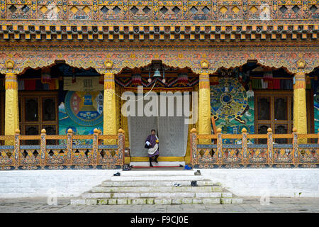 Local man at the entrance to the coronation temple at the monastery and fortress Punakha Dzong, Punakah, Bhutan - Stock Photo