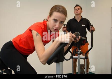 Couple Exercising in Fitness - Stock Photo