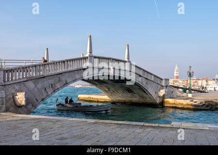 Venice, Italy Stone bridge over the Rio de l'Arsenal canal - Stock Photo