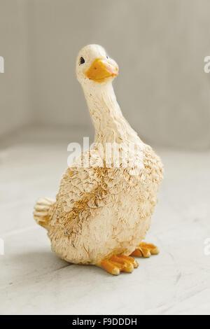 Ceramic goose figurine on light background - Stock Photo