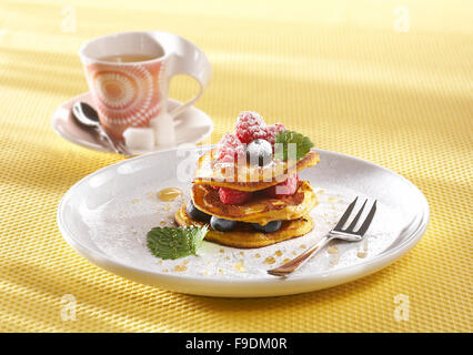 Pumpkin Pancakes with Fruit and Maple Syrup - Stock Photo