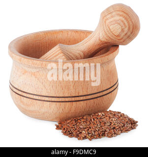 wooden mortar with flax seeds isolated on white background - Stock Photo