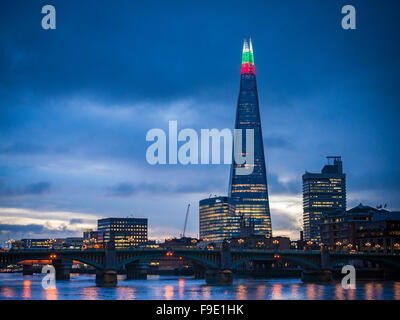 The Shard Building light's up for the Christmas season with alternating Green, Red and White lights at the top, - Stock Photo