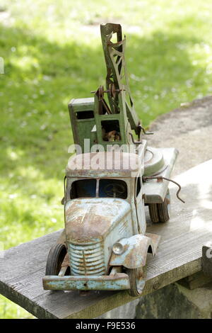 Old Car Toy on Bench - Stock Photo
