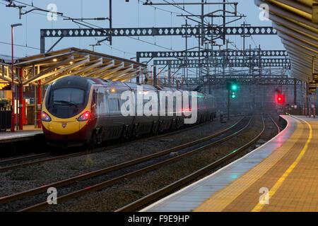 Virgin Trains Pendolino electric train at Rugby railway station, Warwickshire, UK - Stock Photo