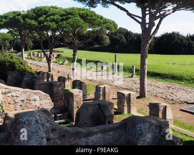 One of the oldest paved roads in the world, preserved in Ostia Antica near Rome, Italy - Stock Photo