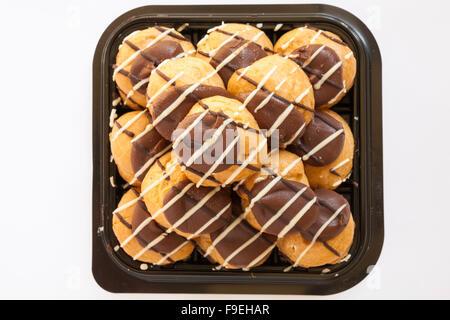 Marks & Spencer profiterole stack dessert isolated on white background - Stock Photo