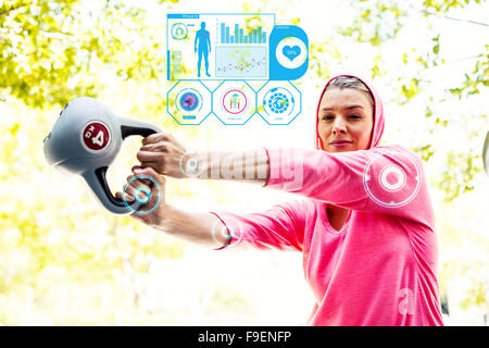 Composite image of a pretty woman in a pink outfit doing exercise with a weight - Stock Photo