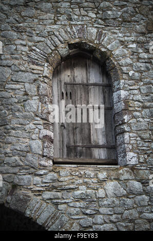 Shuttered Arched Window belonging to lapidarium in Tower Gate House of St. David's Cathedral. - Stock Photo