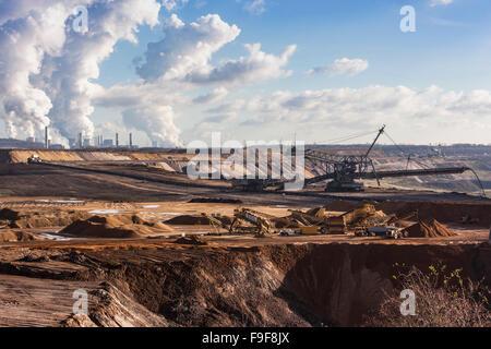 Large excavation machine in the brown coal opencast mining Garzweiler in Northrhine Westphalia, Germany - Stock Photo