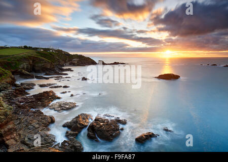 A winter sunrise over Polpeor Cove, The Lizard Cornwall - Stock Photo