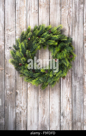 Christmas wreath on wooden door - Stock Photo