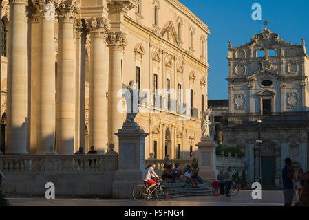 Sicily Baroque, view of the baroque facade of the Cathedral (duomo) and the Santa Lucia alla Badia church (right) - Stock Photo