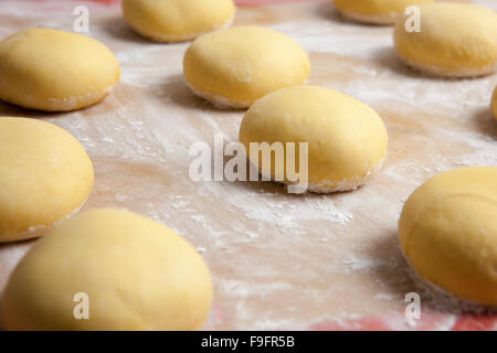dough, fresh dough for making cakes and pastries with different fillings, menus, fast food, pastry, cakes, sweet - Stock Photo