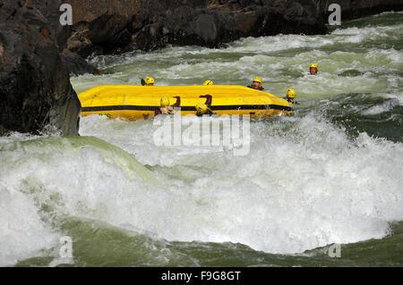Flipped raft at The Boiling Pot on the Zambezi River in Zambia - Stock Photo