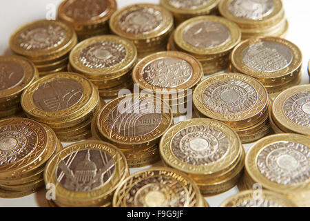 Overhead shot of UK £2 coins stacking in piles of £10. - Stock Photo