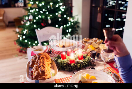 Christmas Meal Laid On A Table In Decorated Living Room