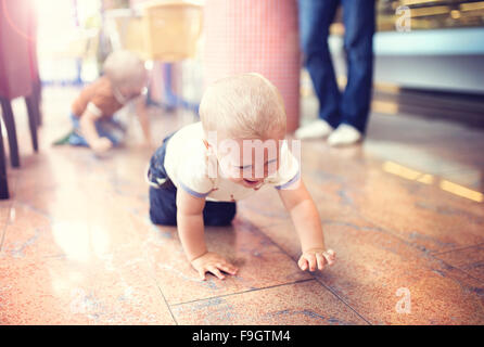 Little boy enjoying their time in cafe - Stock Photo