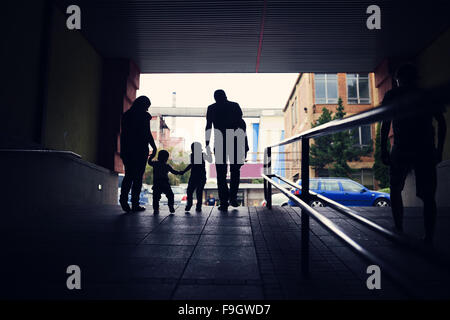 Young family with two little boys in a subway - Stock Photo
