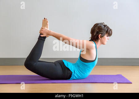 Dhanurasana Yoga pose - Stock Photo
