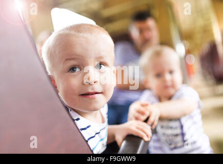 Family with two children traveling in train. - Stock Photo