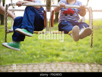 Two cute little boys on an old carousel. - Stock Photo