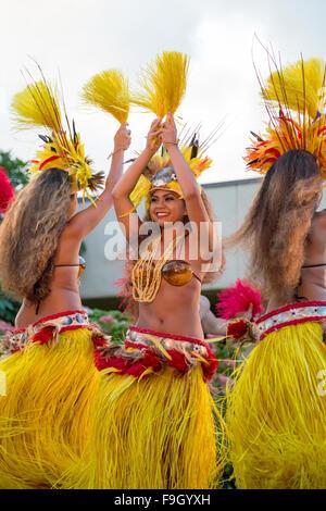 Three female dancers performing the Hula dance, Kauai - Stock Photo