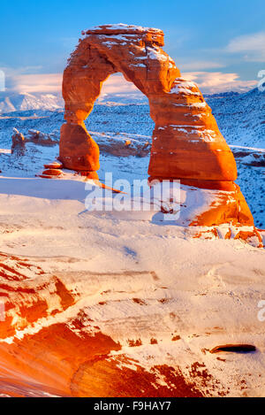 Delicate Arch, Arches National Park, Utah La Sal Mountains beyond, Heavy Winter Snow - Stock Photo