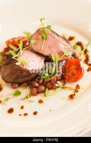 Santa Maria BBQ tri tip with pinquito beans, Barbareno Restaurant, Santa Barbara, California - Stock Photo
