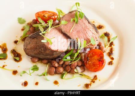Santa Maria BBQ tri-tip with pinquito beans, Barbareno Restaurant, Santa Barbara, California - Stock Photo