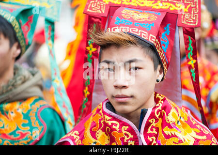 Paris, France - Feb 17, 2013: Young chinese performer in traditional costume at the chinese lunar new year parade - Stock Photo