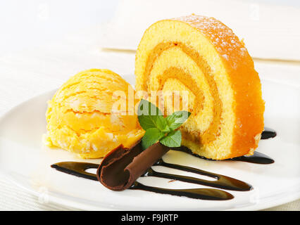 Swiss Roll with yellow sherbet - Stock Photo