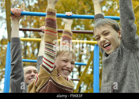 Active boy playing on monkey - Stock Photo