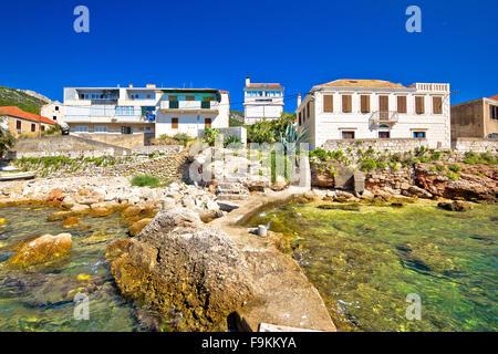 Rocky coast of Komiza on Vis island, turquoise beach in Dalmatia, Croatia - Stock Photo