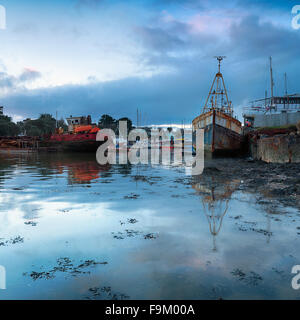 An old boat yard at Torpoint in Cornwall where the river Tamar meets the sea - Stock Photo