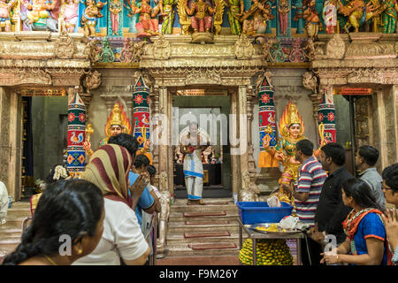 ceremony and worshippers,  Sri Veeramakaliamman Hindu temple, Singapore, Asia - Stock Photo