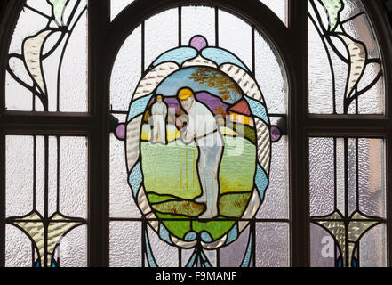 Cricketer window at Victoria Baths in Manchester, which opened in 1906 and served the public for 87 years, is now - Stock Photo