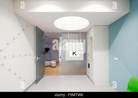 Waiting room in the children's centre at the Eye Hospital, Rotterdam, The Netherlands. White and pale blue walls. - Stock Photo