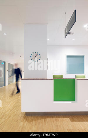 Waiting room in the children's centre at the Eye Hospital, Rotterdam, The Netherlands. A staff or reception desk. - Stock Photo
