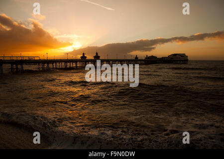 Blackpool, UK. 17th December, 2015. A glorious sunset appears over Blackpool's North Pier as the unseasonably warm - Stock Photo