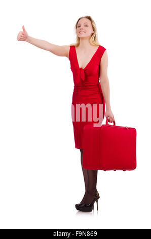 Smiling woman in red dress with suitcase isolated on white - Stock Photo