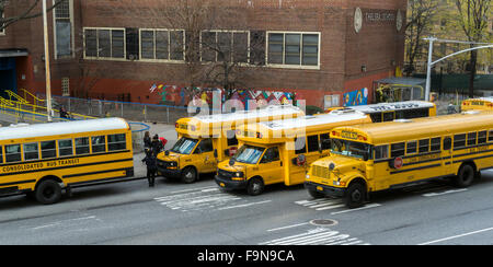 School buses line up in front of PS 33 in Chelsea in New York on Tuesday, December 15, 2015 for normal dismissal - Stock Photo