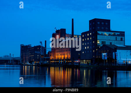 View of Innenhafen, Inner Harbour, at dusk, with Küppersmühle and Werhahnmühle, Duisburg, Ruhr Area, Germany - Stock Photo