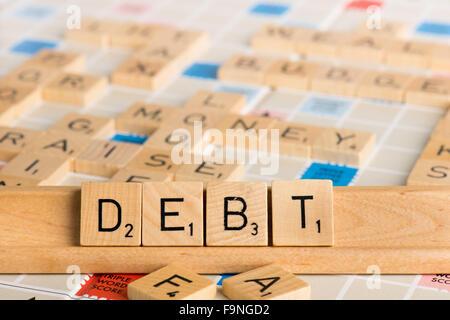 Scrabble - DEBT - Stock Photo