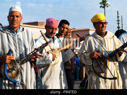 Berber musicians playing the Imzad  ( single string instrument ) in the Djema el-Fna sq. in Marrakesh. - Stock Photo