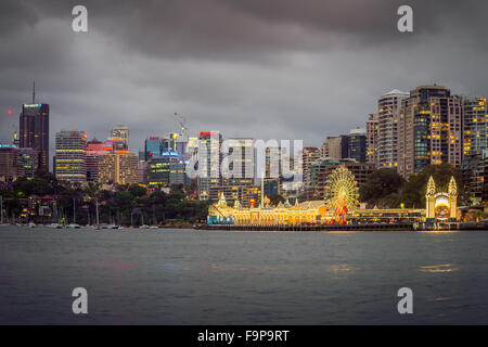 Sydney, Australia - November 7, 2015: Night view of Luna Park with office buildings in background. Long exposure - Stock Photo