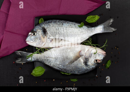 Delicious fresh fish on dark vintage background fish with for Aromatic herb for fish