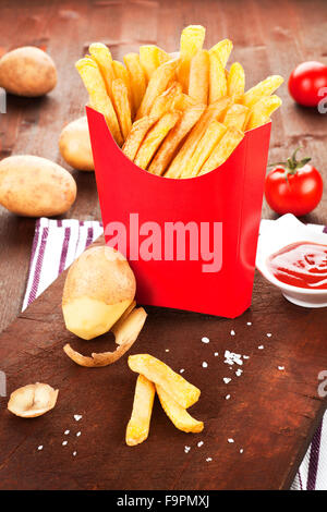 French fries in red paper bag. - Stock Photo