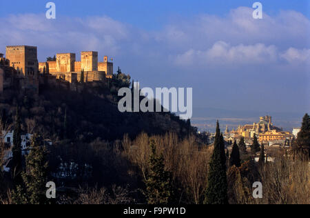 Alhambra and cathedral, as seen from Sacromonte troglodyte quarter (Gipsy quarter), Granada, Andalusia, Spain, Europe. - Stock Photo
